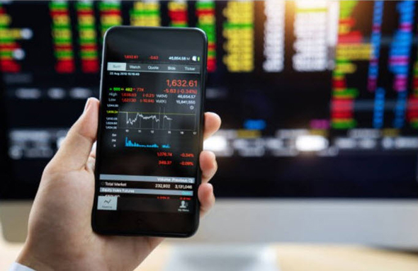 Day traders rely on apps to folow the market. Photo: Getty images