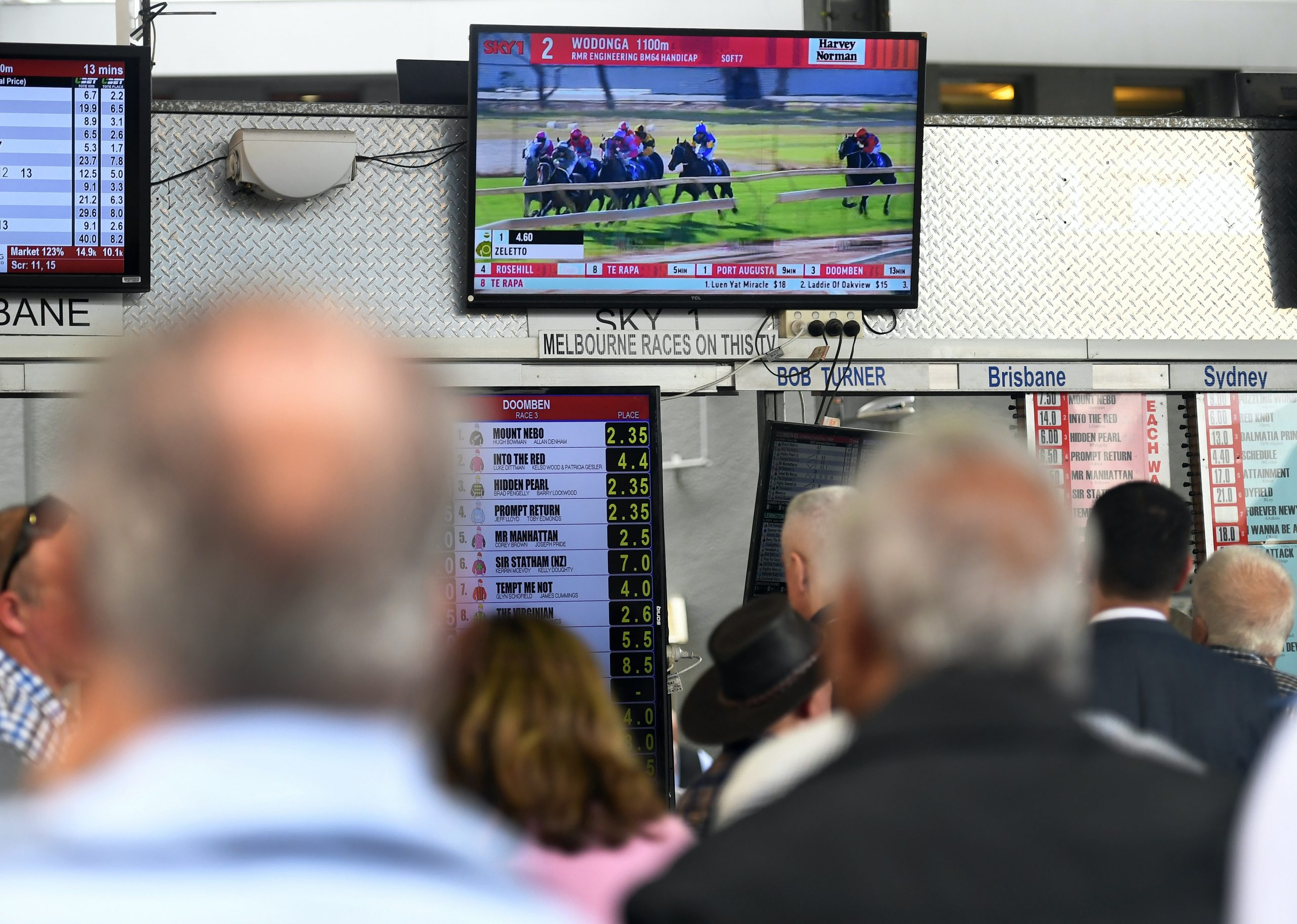 Punter watch a horse race on television